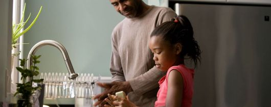 African-american-father-was-shown-in-the-process-of-teaching-his-young-daughter